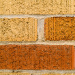 Orange, Red, and Tan Brick Wall Background — Stock Photo #2866393