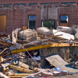 A demolition site with a pile of demolished bric — Stockfoto