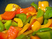 Frying red, green and yellow bell peppers — Stock Photo