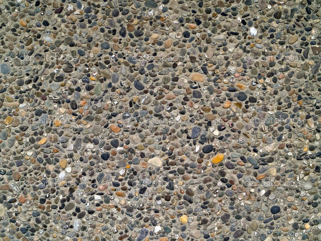 Concrete wall made of small river rocks stock photo for Small river pebbles