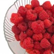 Raspberries Close Up in a Bowl on White — Stock Photo