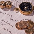 A Stock Market Sheet with Dice, Dollars, Compass — Stock Photo