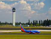 Air Traffic Control Tower and an Airplane on the — Stock Photo