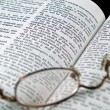 The Bible opened to the Book of Proverbs with Glasses — Stock Photo