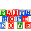 ABC Blocks spelling Faith Hope and Love - Stock Photo