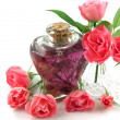 Soft Pink Roses Arranged with Massage Oil in Romantic Scene — Stock Photo #3348461