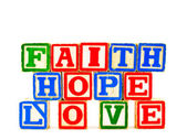 ABC Blocks spelling Faith Hope and Love — Stock Photo