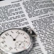Stock Photo: Bible opened to Matthew 24: 36 with Pocketwatch