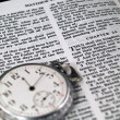 The Bible opened to Matthew 24: 36 with a Pocketwatch — Stock Photo #3394643