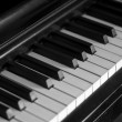 Piano keys of a very well loved and often played piano — Stock Photo