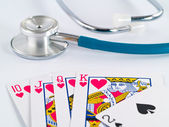 Stethoscope and Playing Cards as a Gambling with your Health Concept — Stock Photo