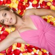 woman in rose petals — Stock Photo