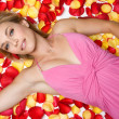 Stock Photo: Woman in Rose Petals