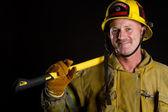 Firefighter holding axe — Stock Photo