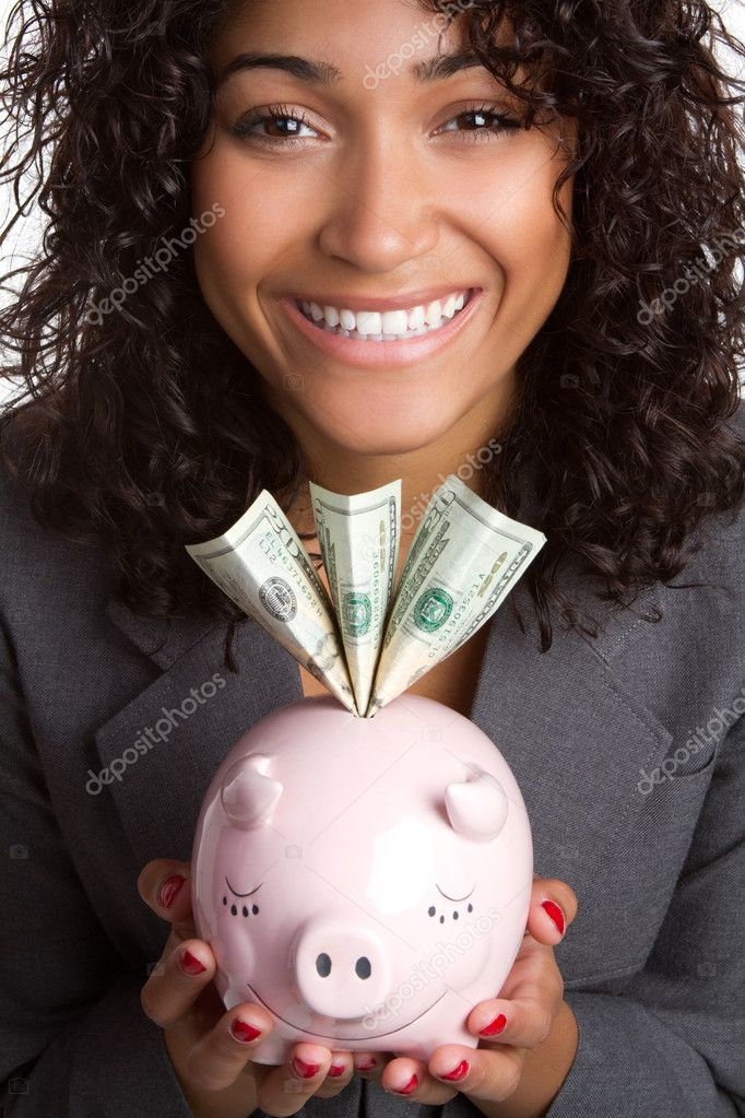 Smiling black woman holding piggy bank — Stock Photo #3153125