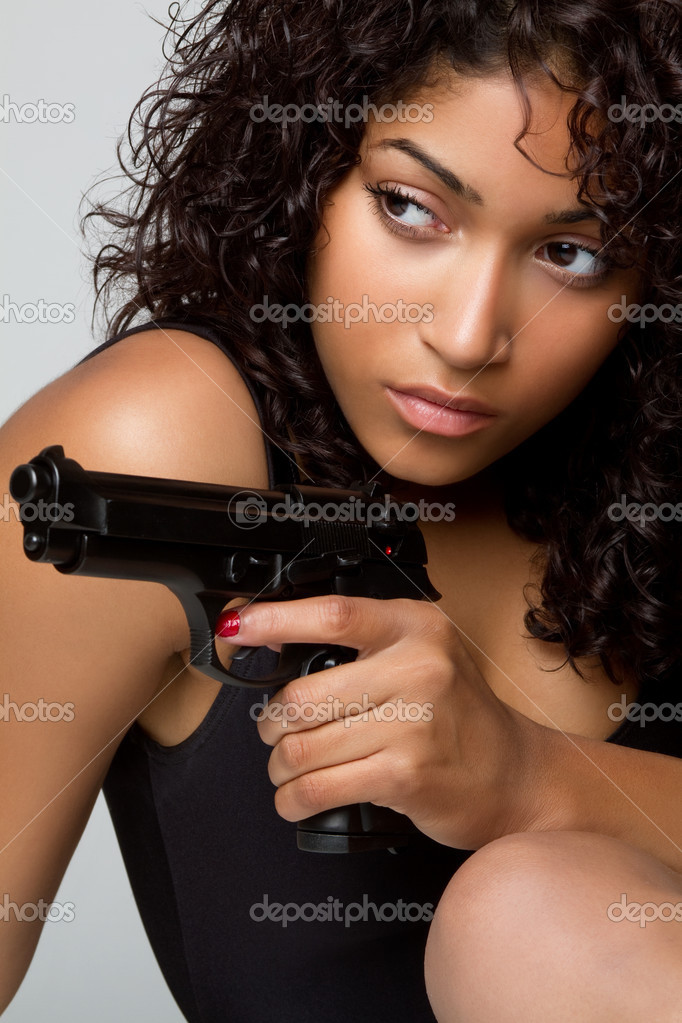 Sexy black woman holding gun — Stock Photo #3166765