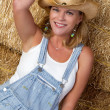 Cowgirl in Hay - Stock Photo