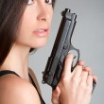 Woman Holding Gun — Stock Photo