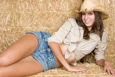 Cowgirl in Hay — Stock Photo