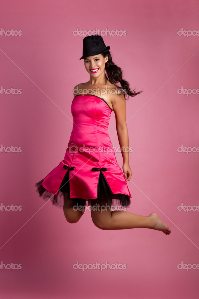 Beautiful smiling latina woman jumping  Stock Photo #3567809