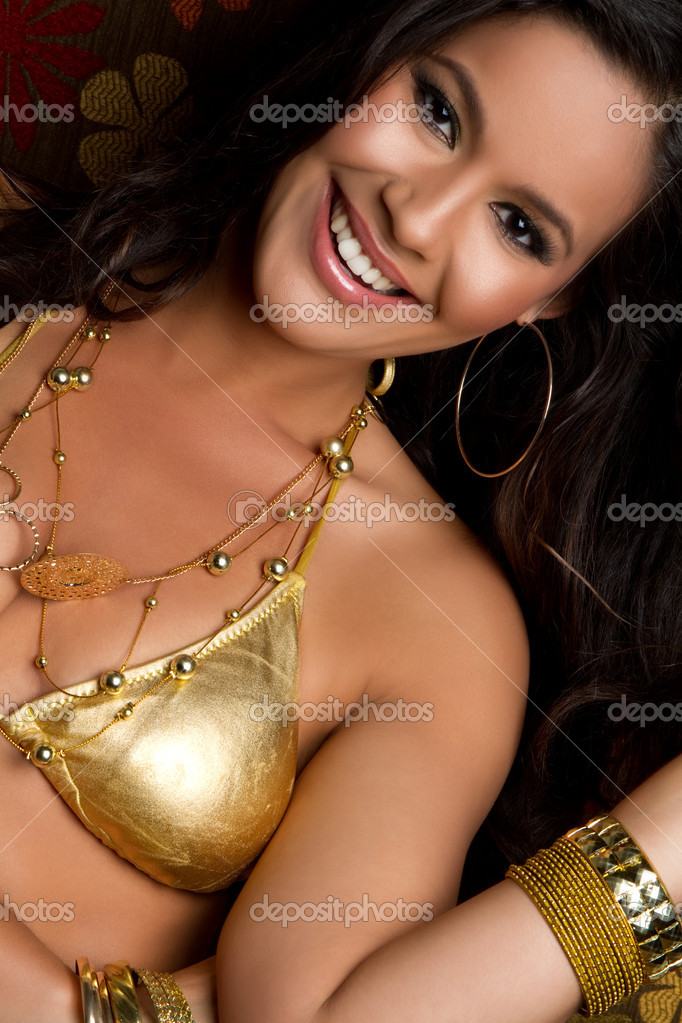 Beautiful smiling gold bikini woman — Stock Photo #3567810