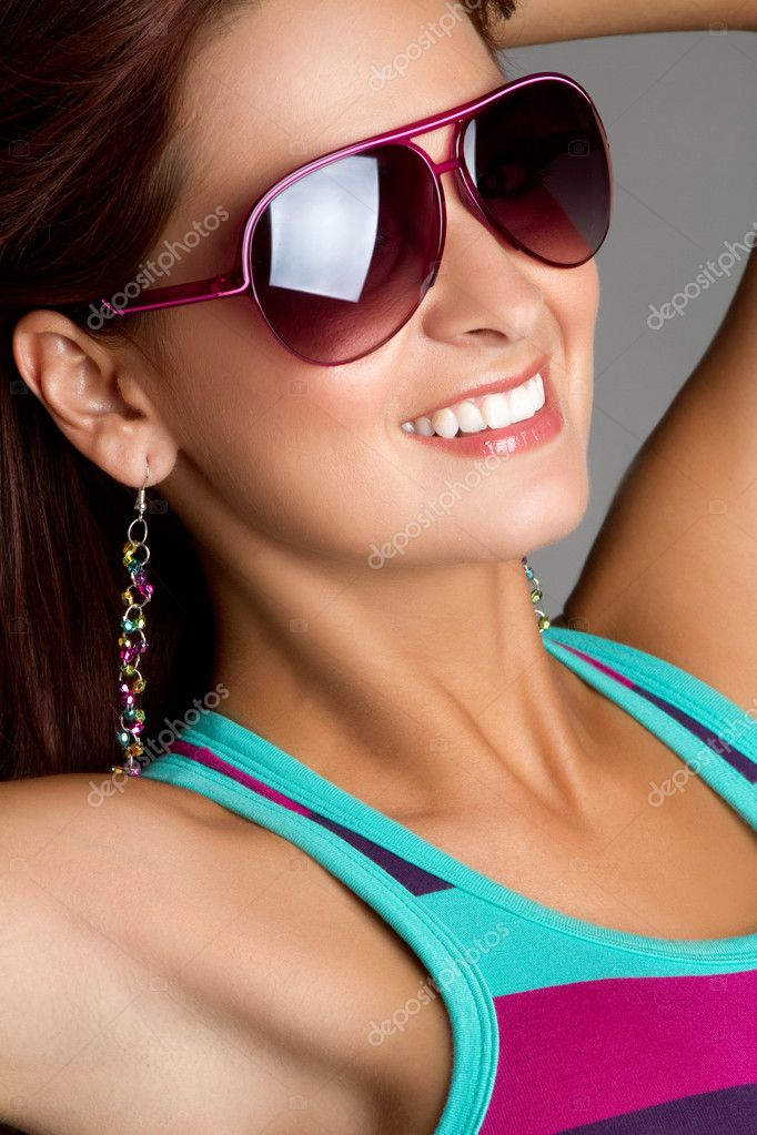 Beautiful smiling woman wearing sunglasses  Stock Photo #3570316