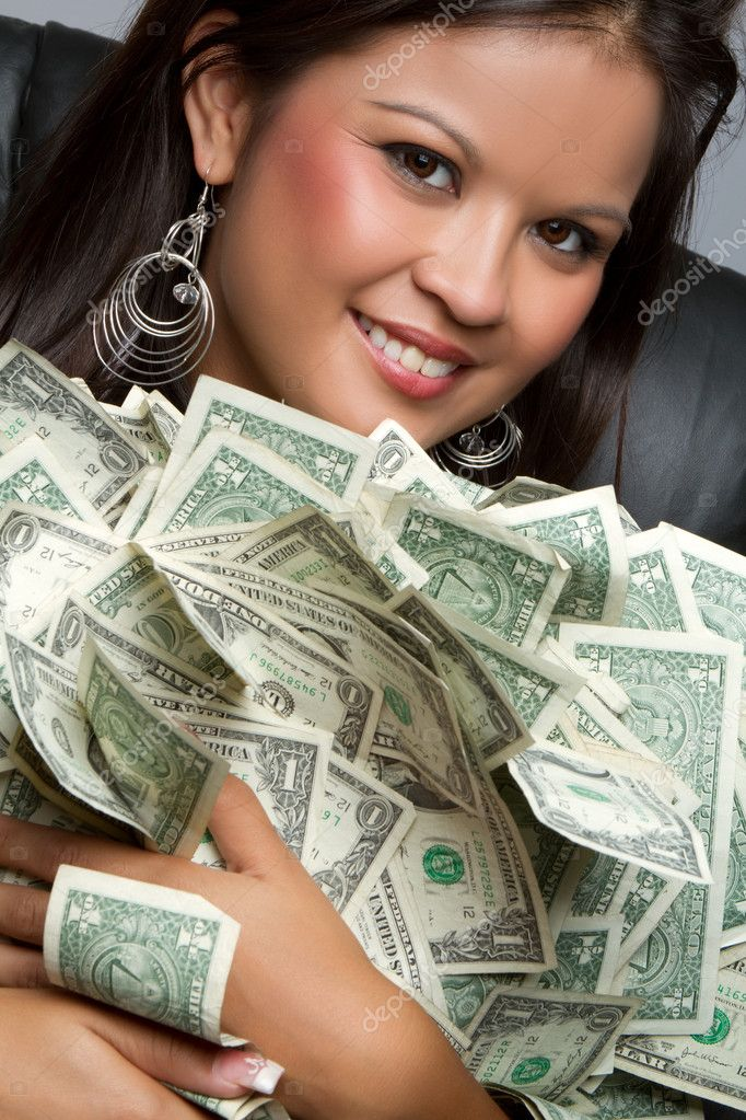Smiling asian woman holding money — Stock Photo #3702585