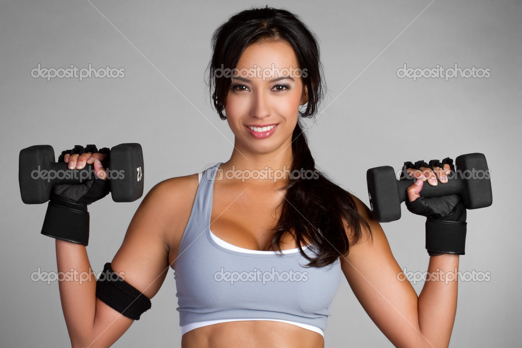 Beautiful latin woman lifting weights — Stock Photo #3702647