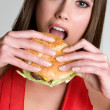Woman Eating Hamburger — Stock Photo #3733956