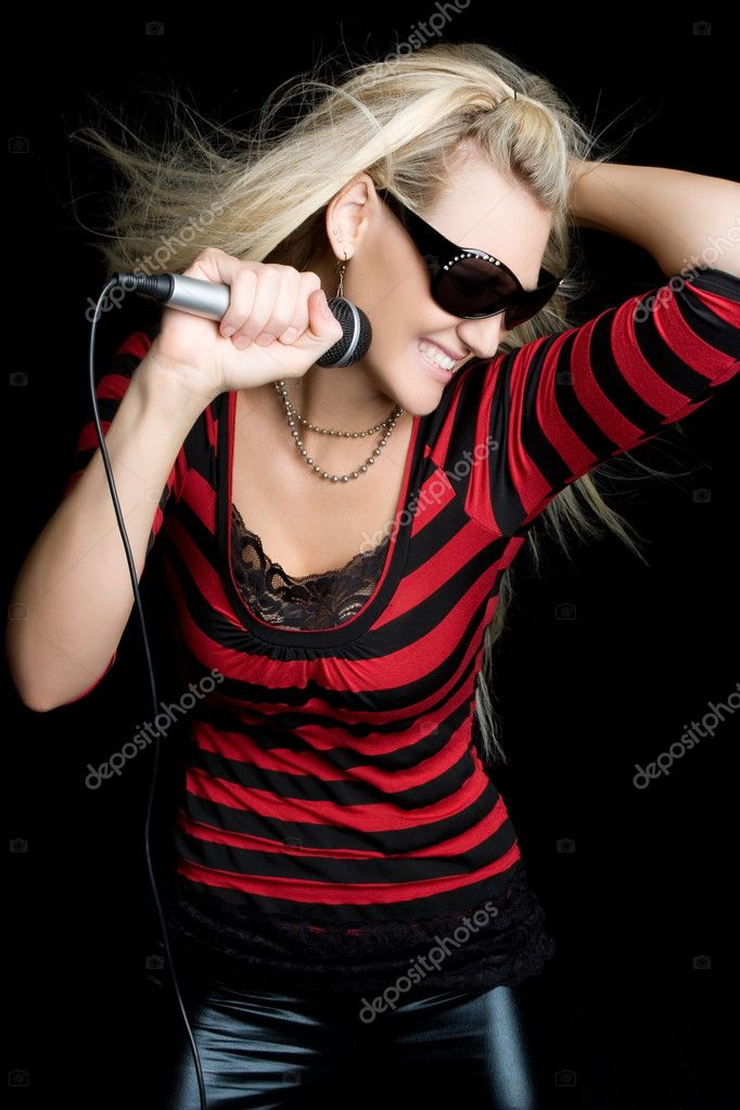 Pretty blond rock star girl singing — Stock Photo #3733907