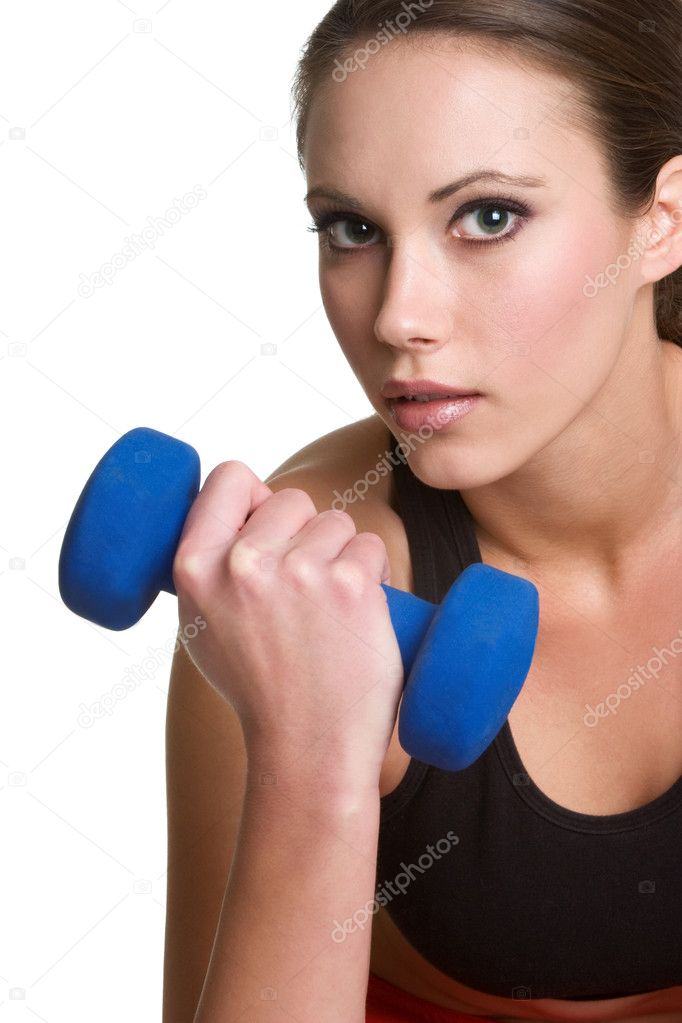 Beautiful woman lifting weights  Stock Photo #3733939