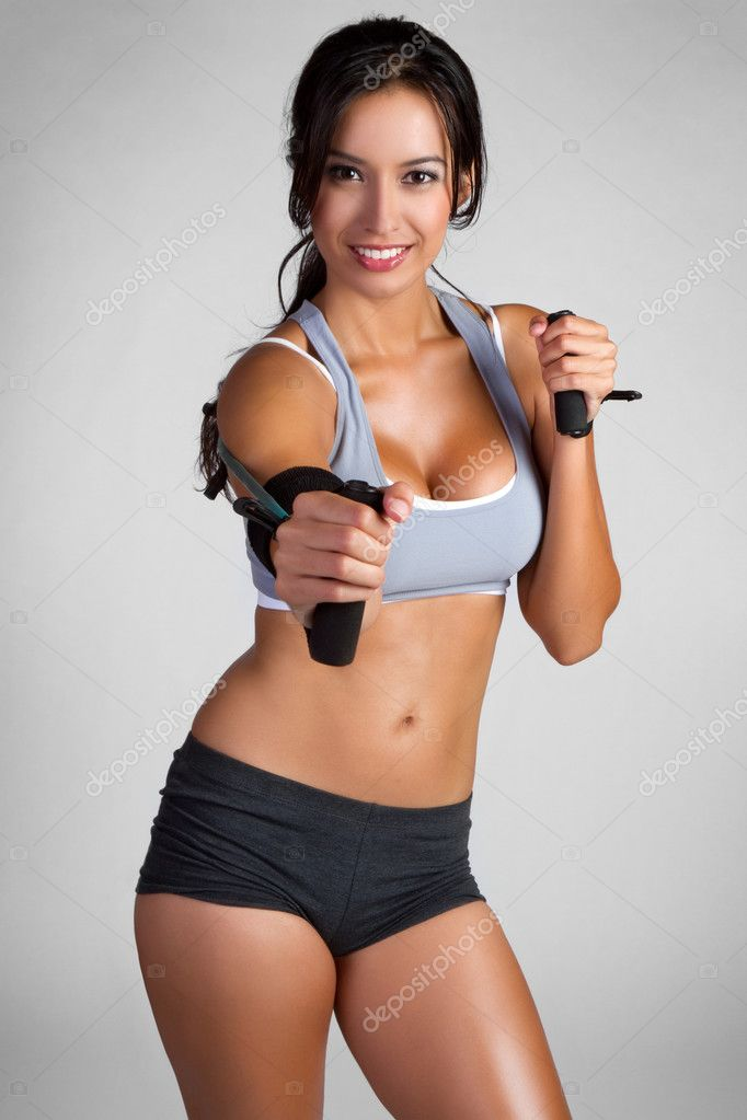 Beautiful smiling fitness woman exercising — Stock Photo #3784263