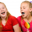 Royalty-Free Stock Photo: Girls are showing their blue tongue af