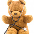 Bown teddybear acting as a doctor — Stock Photo