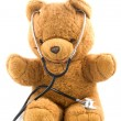 Stock Photo: Bown teddybear acting as doctor