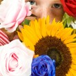 Girl is holding lots of flowers — Stock Photo
