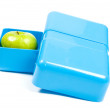Stock Photo: Blue lunchbox with green apple