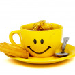 Happy yellow cup of tea with a cookie — Stock Photo
