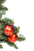Red christmas ball in tree — Stock Photo