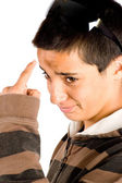 Teenage boy is pointing to his forhead — Stock Photo