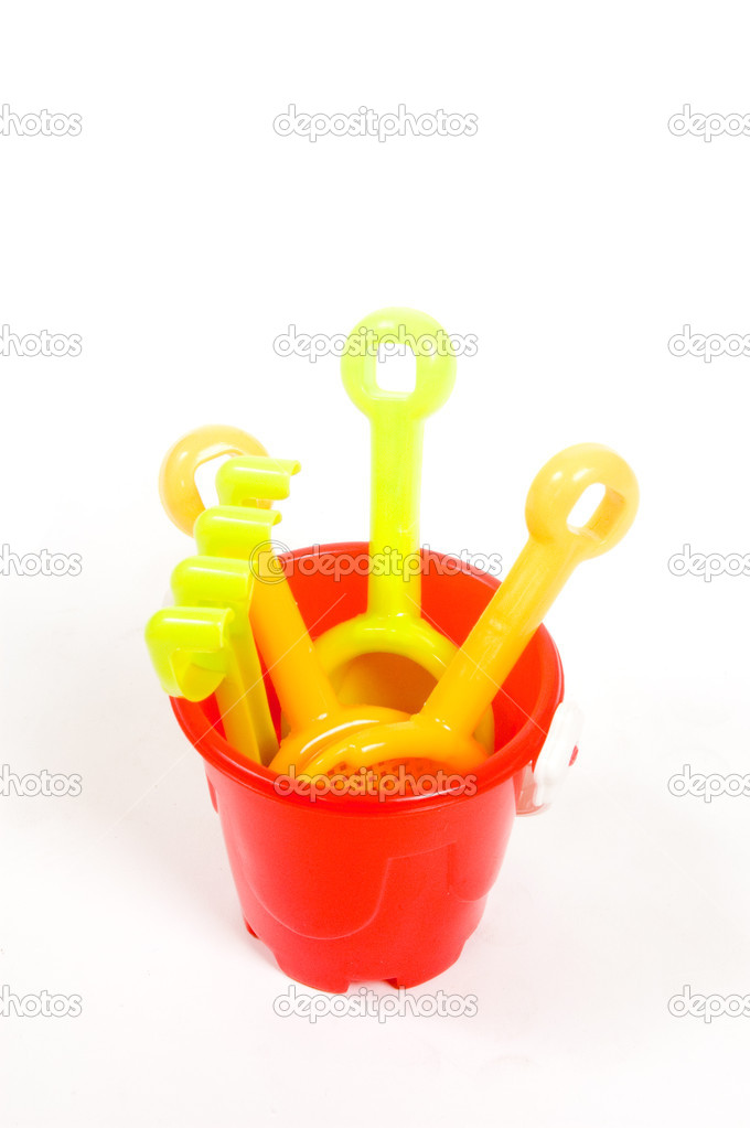 Red bucket and toys, isolated on white background  Stock Photo #2762589