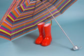 Red children rain boots — Stock Photo