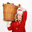 Little santa claus holding a basket — Stock Photo
