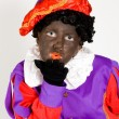 Girl dressed up as zwarte piet - Stock Photo