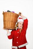 Little santa claus holding a basket — Stock Photo