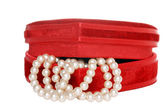Cream pearls in a red box — Stock Photo