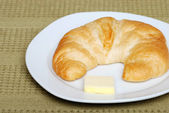 Crescent with butter — Stock Photo