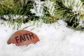 Faith stone in snow — Stock Photo