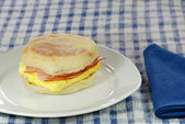 Ham and egg english muffin on a plate — Stock Photo