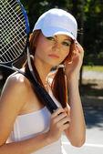 Headshot of young woman tennis player — Stockfoto